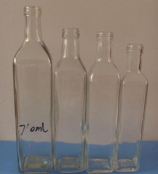 各种玻璃麻油瓶的前景